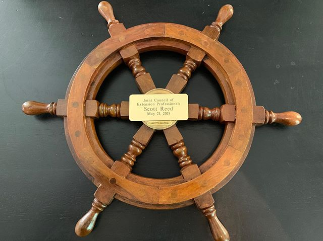Cool ship wheel with an added engraved plate.