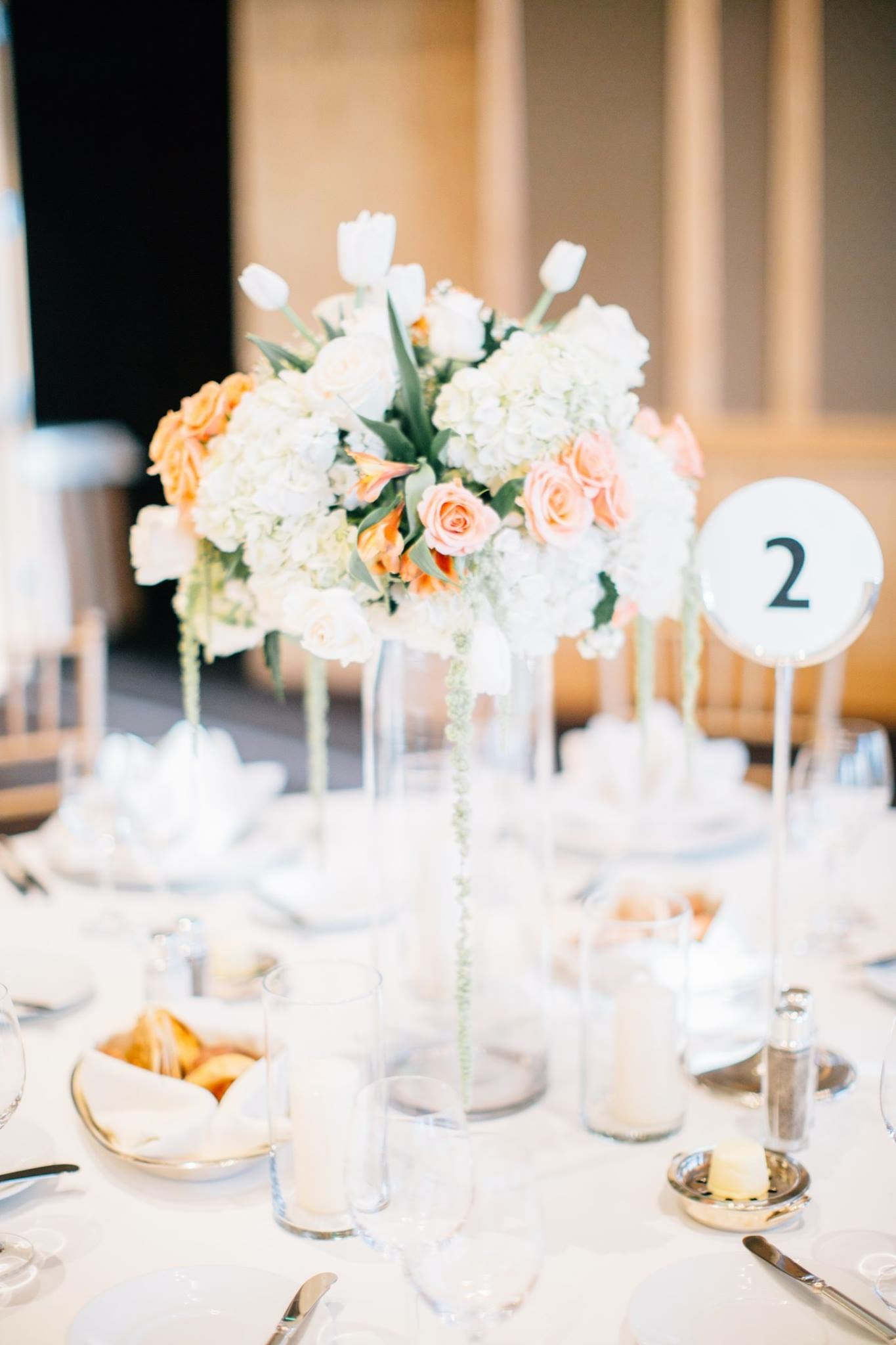 We made sure to position the taller of the centerpieces in such a way as to allow guests to see each other across the table for better conversation during dinner and dancing. The corsages were wristlets worn by the important women in the couple's family.