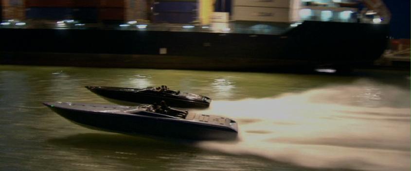 Miami Vice: Two Donzis race down Government Cut in Miami at night.