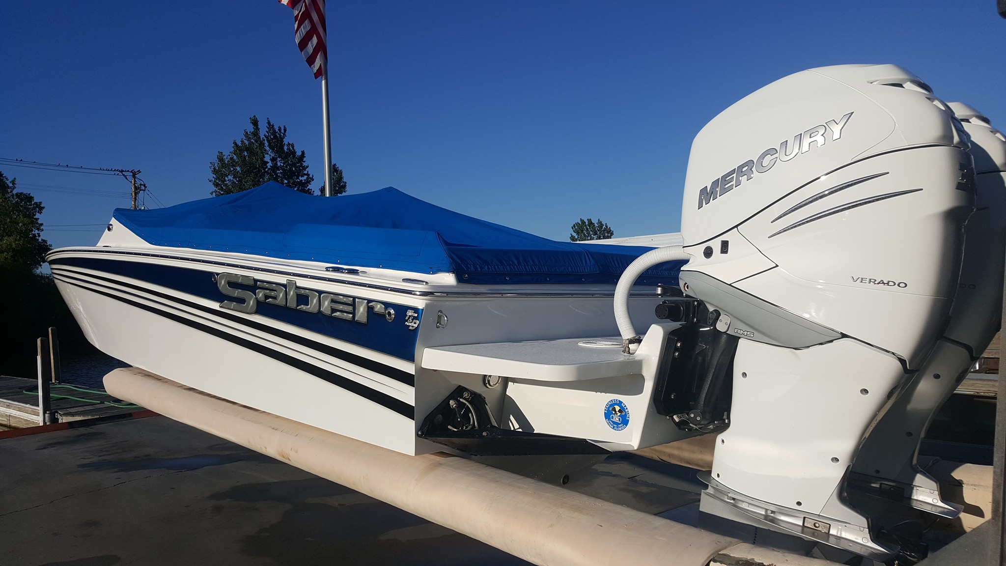 Saber Marine builds their beautiful 28 with outboards. A Stainless Marine bracket allows for an easy installation. Saber's are well built, traditional narrow hull offshore designs. Made in Michigan.