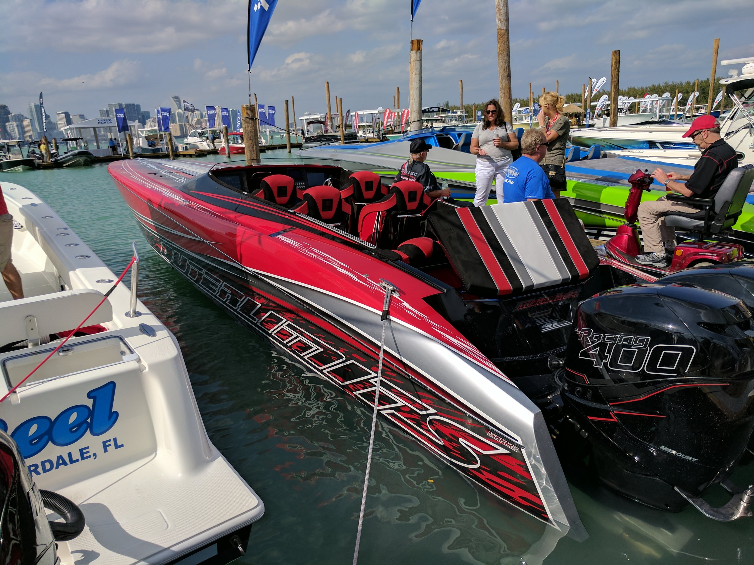 If you even have to ask how much money this is, just keep walking bro. Triple 400s, they wanted to put 4 but it is too narrow. This 41 runs around 107 MPH. Good small lake boat!