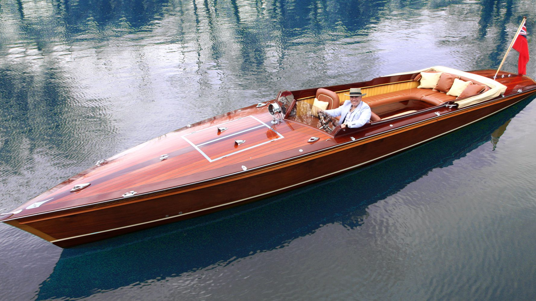Designed by renowned automotive designer Frank Stephenson, a custom 31 electric. DC powered. Not fast and looks expensive. Definitely not a backyard job.Beautiful though.