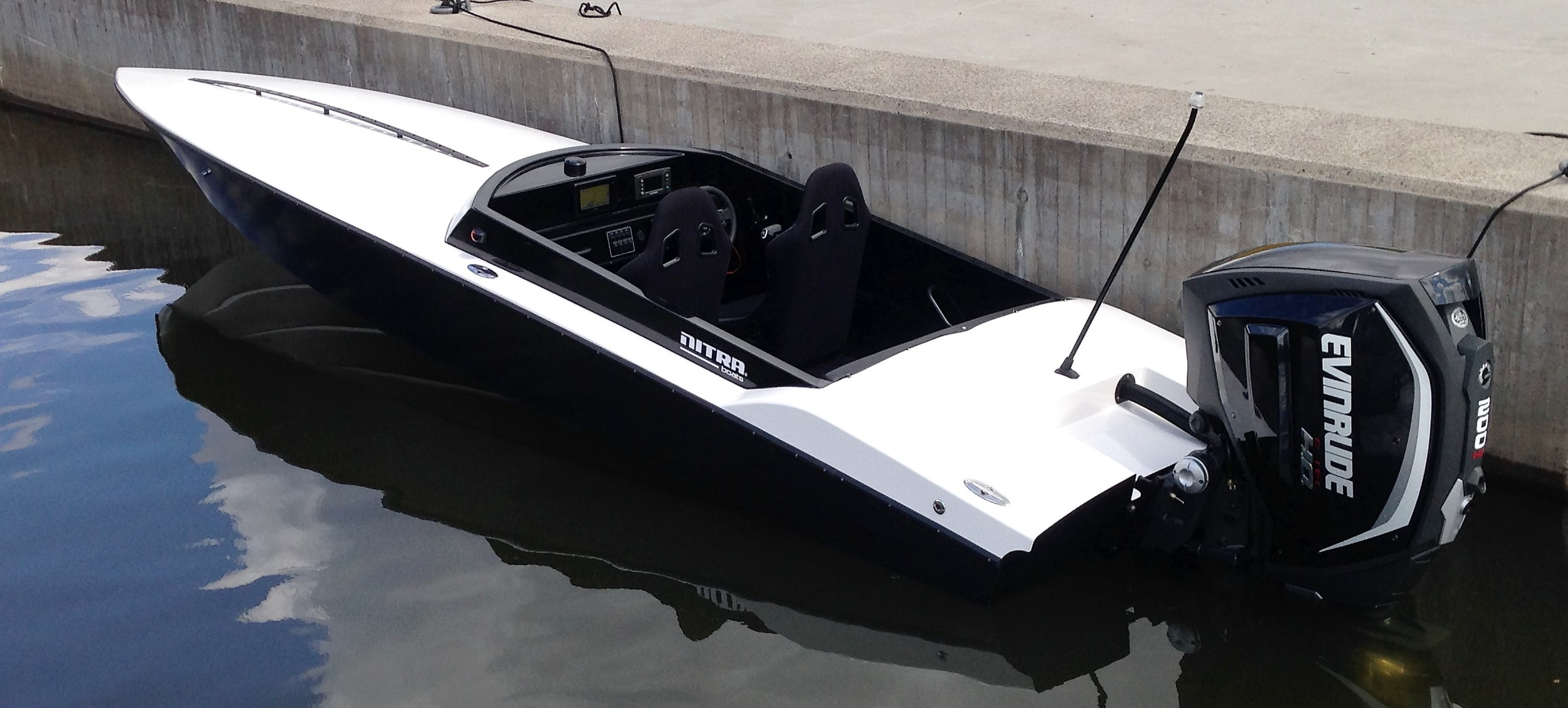 Clean lines and unique curves provide a sophisticated look. Perfect setup here, 75 MPH+ with an Evinrude 200 HO.