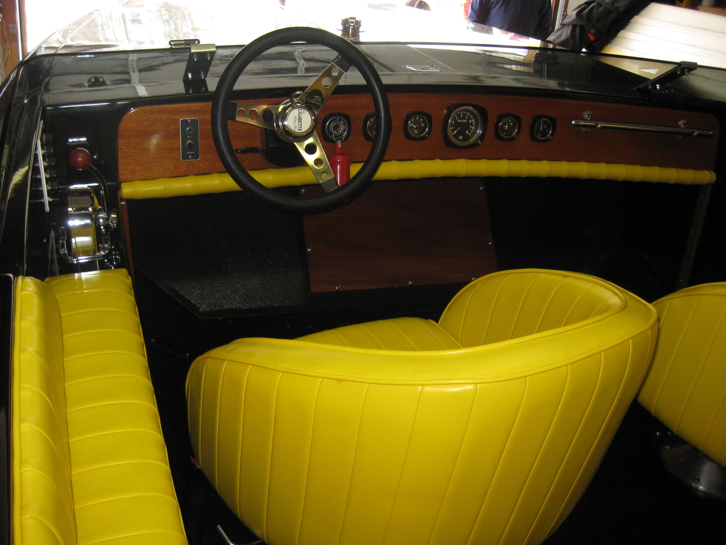 The interior is period correct and like the original with restored hardware, Stewart Warner gauges and a custom reproduction of the original windshield.