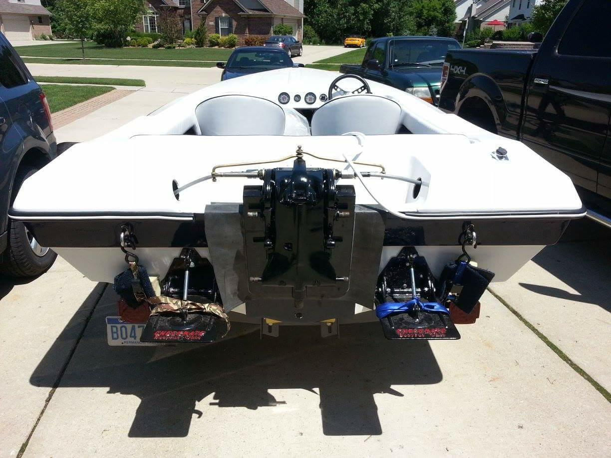 The redone trim tabs, transom and rigging ready for the big Mercury 150.