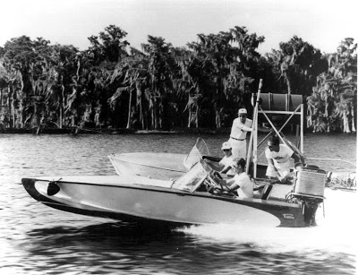 Endurance - The ultimate test for durability and performance. Refueling the 15' Raveau with the iconic Mercury Mark 75. 25,000 miles, at 30 MPH, 24 hrs/day. Part test, part showmanship. (credit:woodyboater.com)