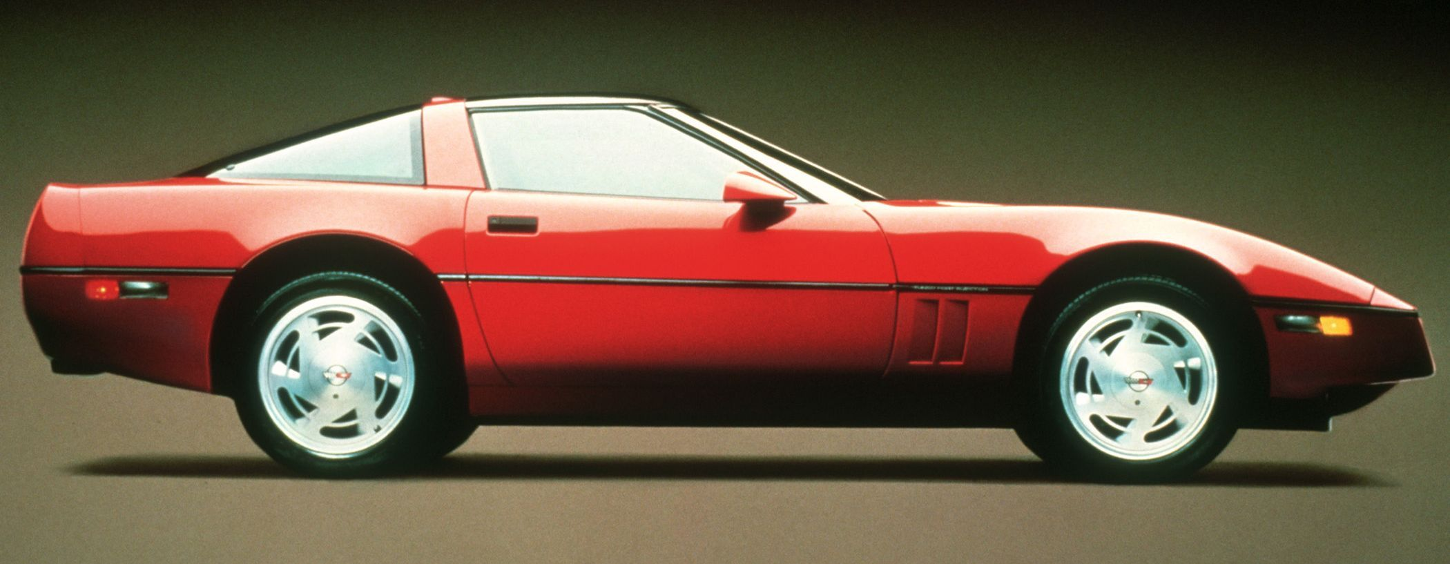 This is a 1990 first generation C4 ZR-1 had subtle differences from a regular Corvette in the body, wider rear quarters were one. Inconspicuous in appearance but not in performance. The promo car was  1991, distinguished by the color matched body insert, and side vents.