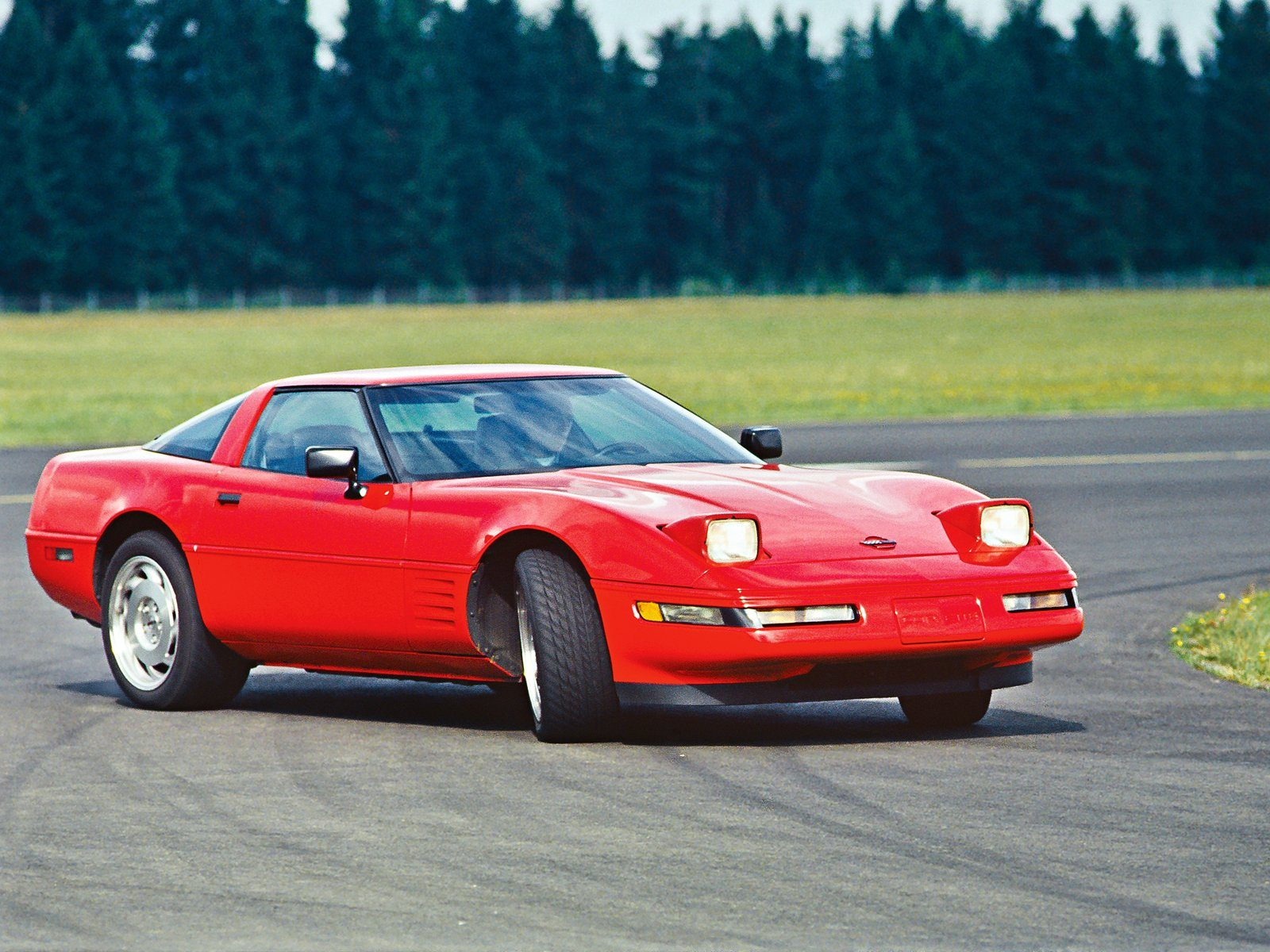A 1991 Red ZR-1 being driven the way it supposed to be driven, sideways.