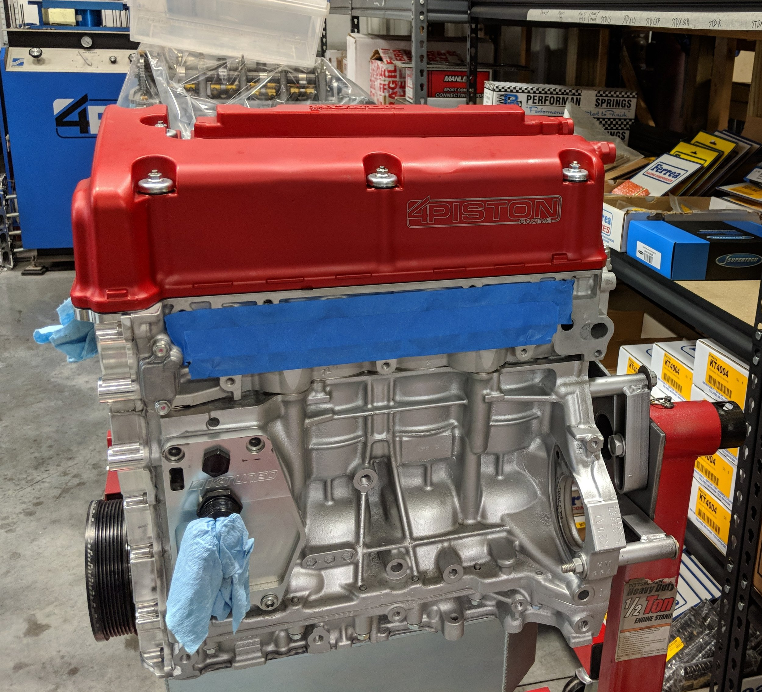 4 Piston Racing focuses primarily on Honda, and their cylinder heads and race engines are incredible, and border on art work, with the impeccable attention to detail. They also make insane power. A K24 seen here.