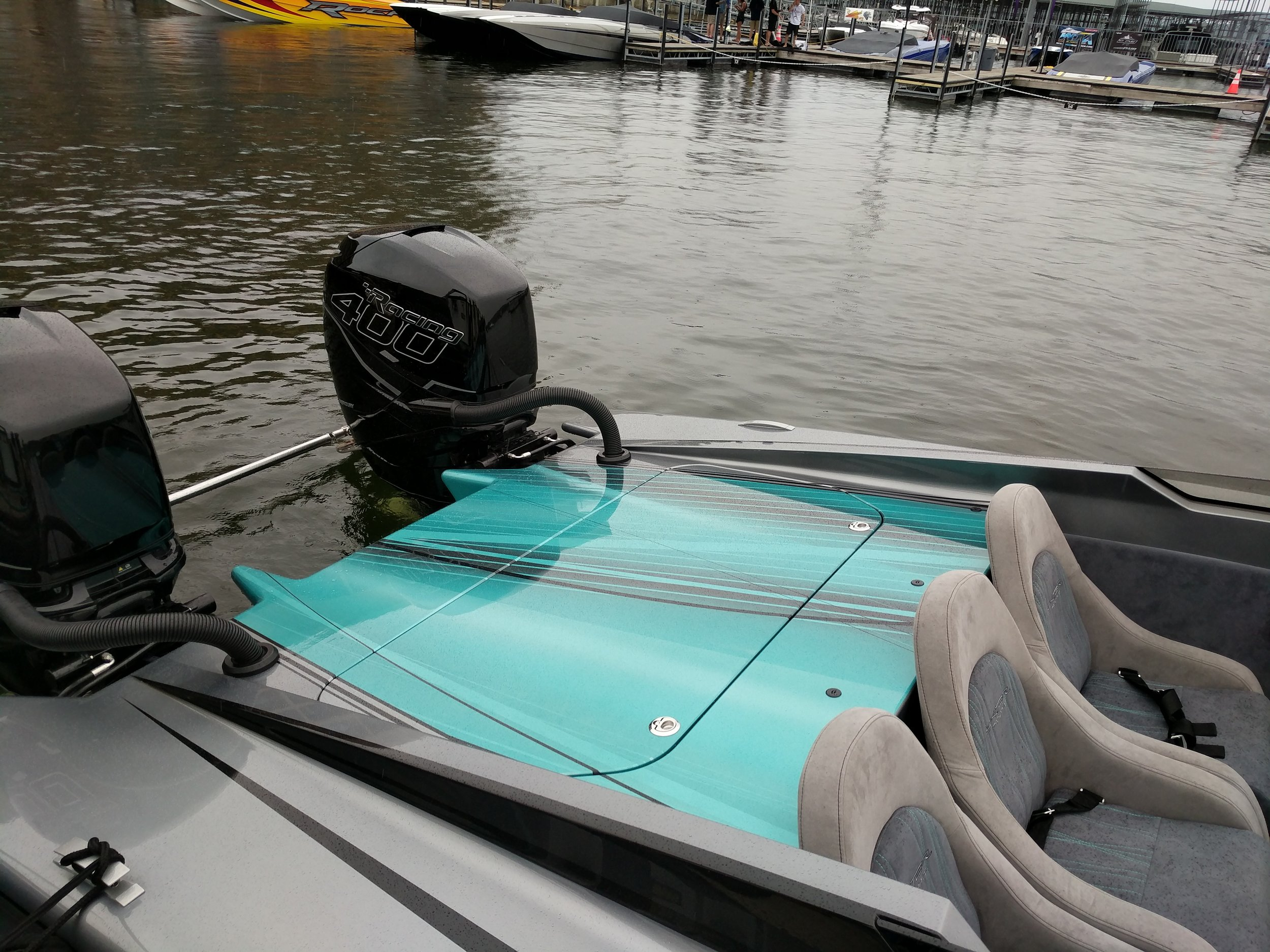 """This is a unique 30' Skater """"Prototype"""" that was converted to outboards by Skater Powerboats, and given a full repaint. This required transom reconfiguration and rear deck customization."""