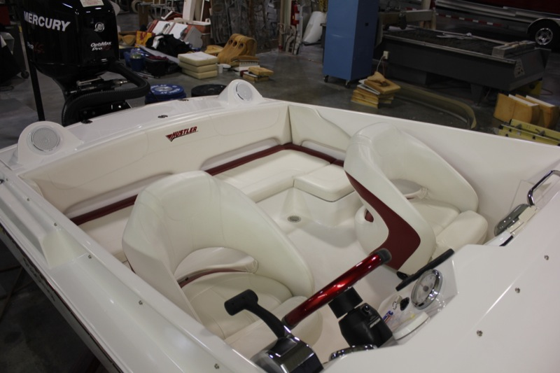Seen here with a 200 Optimax, the boat is without power, but ready for a mechanical Mercury engine. The rear bench has a  small extension on the passenger side. Very nice layout, and top notch finish work from Hustler Powerboats make this 21' footer a real standout.