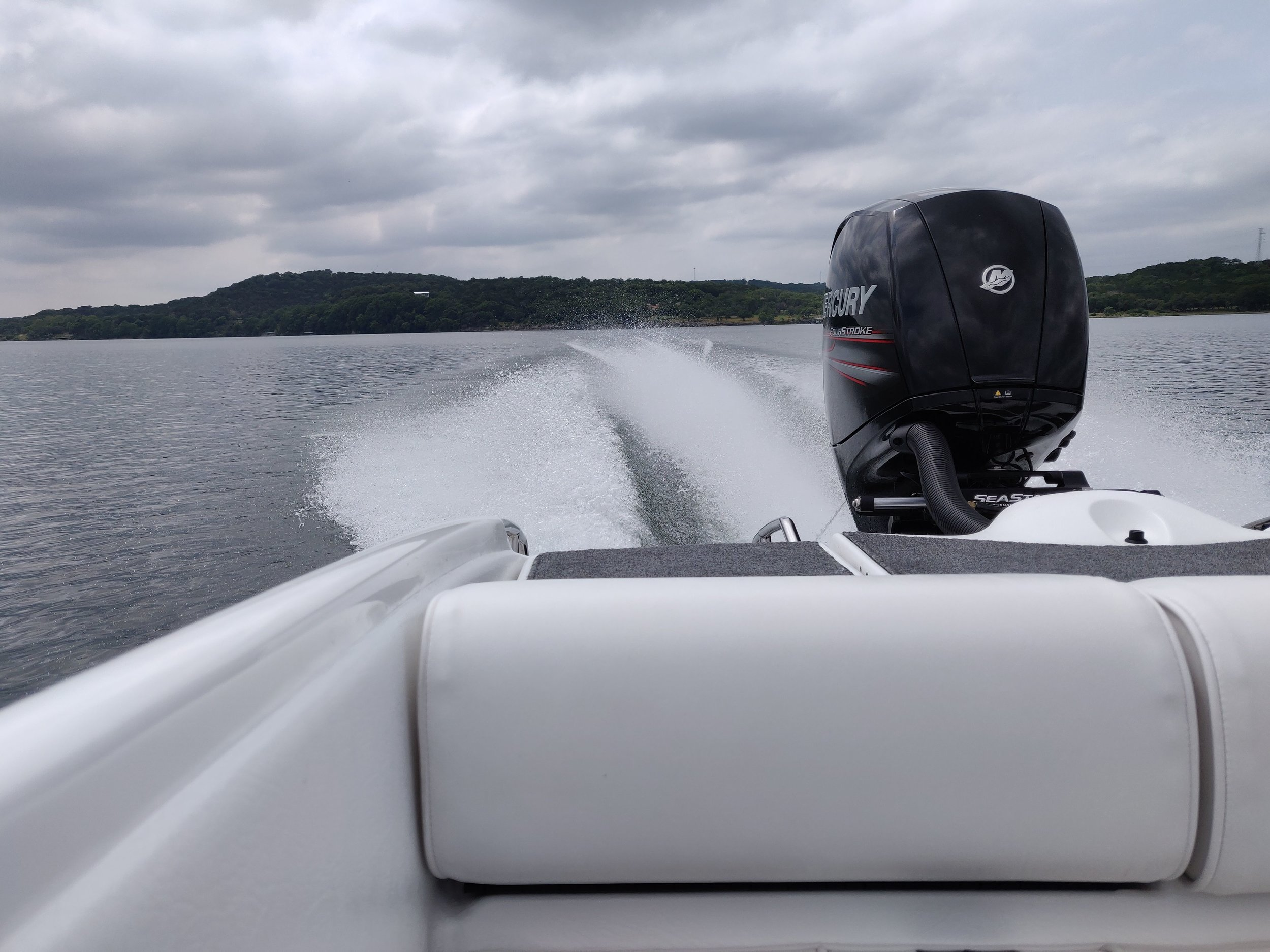 The Mercury 150 HP four stroke works well on this hull. If it had solid mounts, and higher gears, it would be excellent. Being only a 150 HP, you give up top speed, and acceleration, but the new engines are so quiet and efficient. There is very little maintenance, making the Mercury outboard economical to operate.