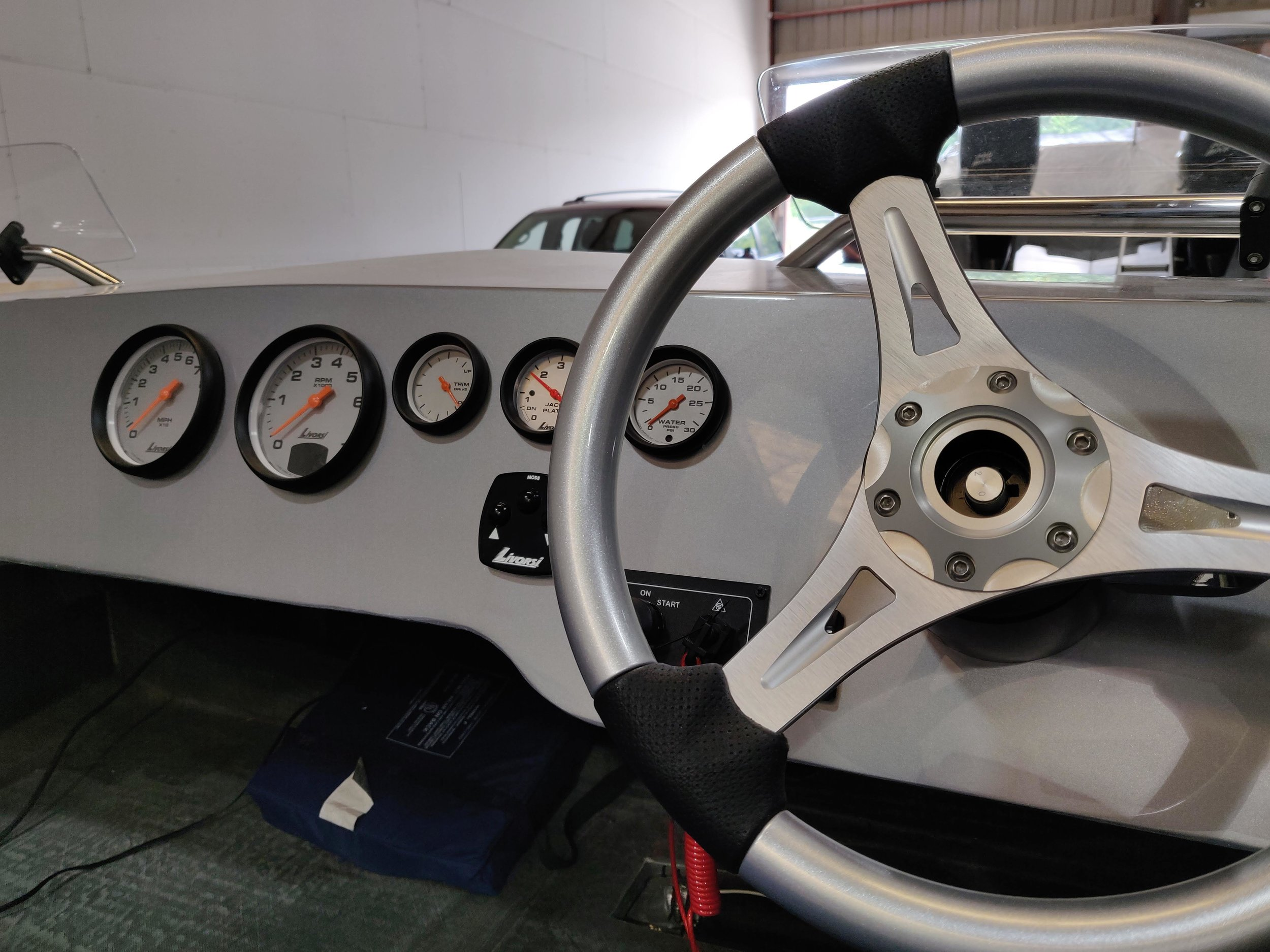 The oversize Livorsi Marine platinum dials, with mega rims look very clean. The dash is all business. The Evinrude Icon screen fits nicely on the starboard side of the helm. The wheel is from Livorsi Marine as well. The seat pictured is just for test fitting, not the actual seat.