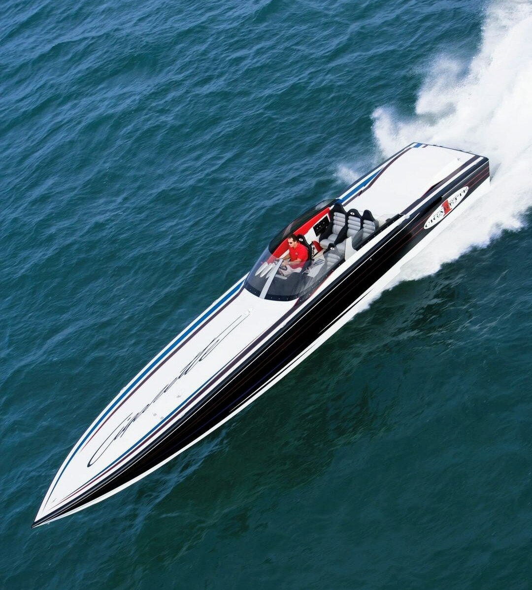 Design - An ultra rare one off 46' Cigarette. With a full windshield and sit down seating, this is the epitome of a luxury offshore sport boat. Imagine it with outboards.