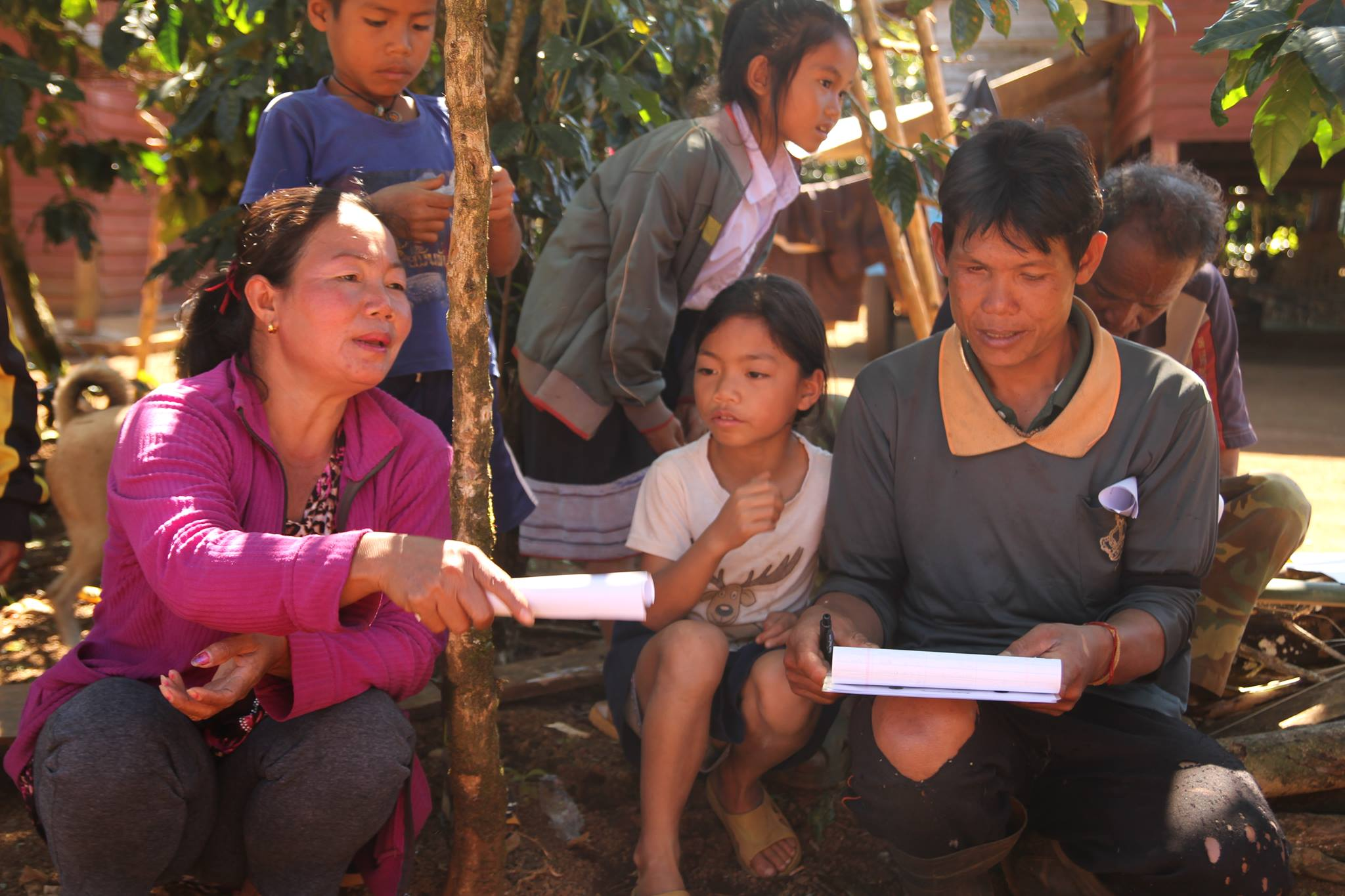 Phoumako village chief, Pheng,voicing her opinion about the traceability program with her son and community children alongside.