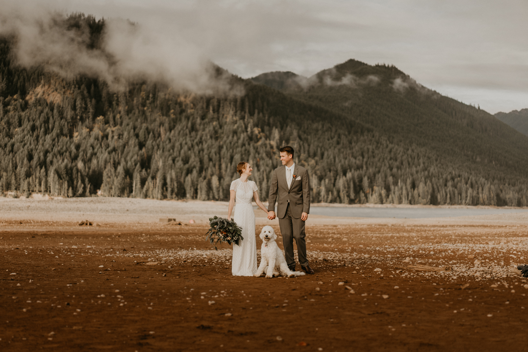 Bride and groom with their dog at Lake Cushman by Olympic National Park for their elopement