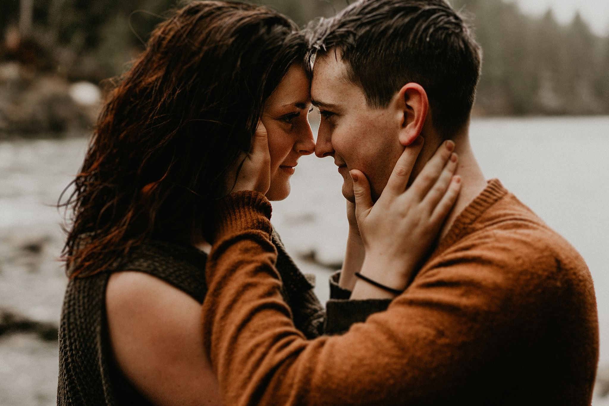 Couple kissing by the river in Snoqualmie