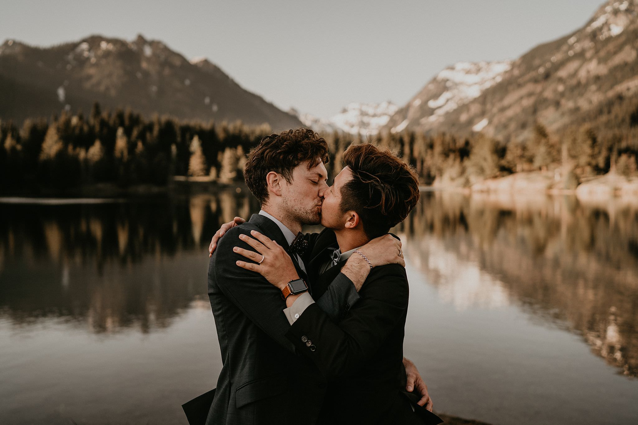 Newlyweds LGBT couple kissed after getting married by Snpqualmie Pass at Gold Creek Pond