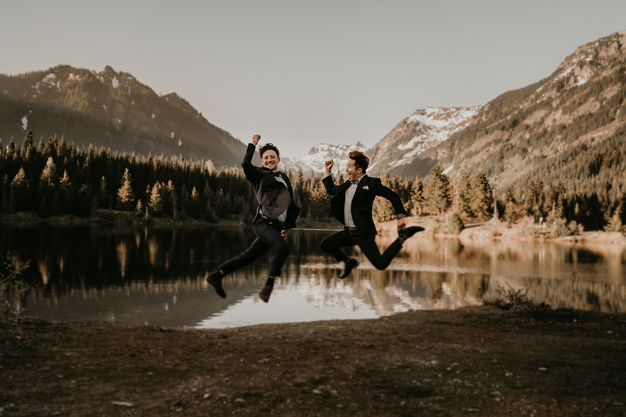 Happiness and intimacy moment from same sex elopement in the PNW by Gold Creek Pond