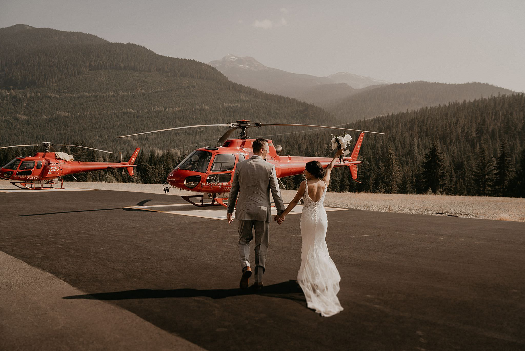 Couple getting married on mountains by Blackcomb Helicopters in whistler mountains