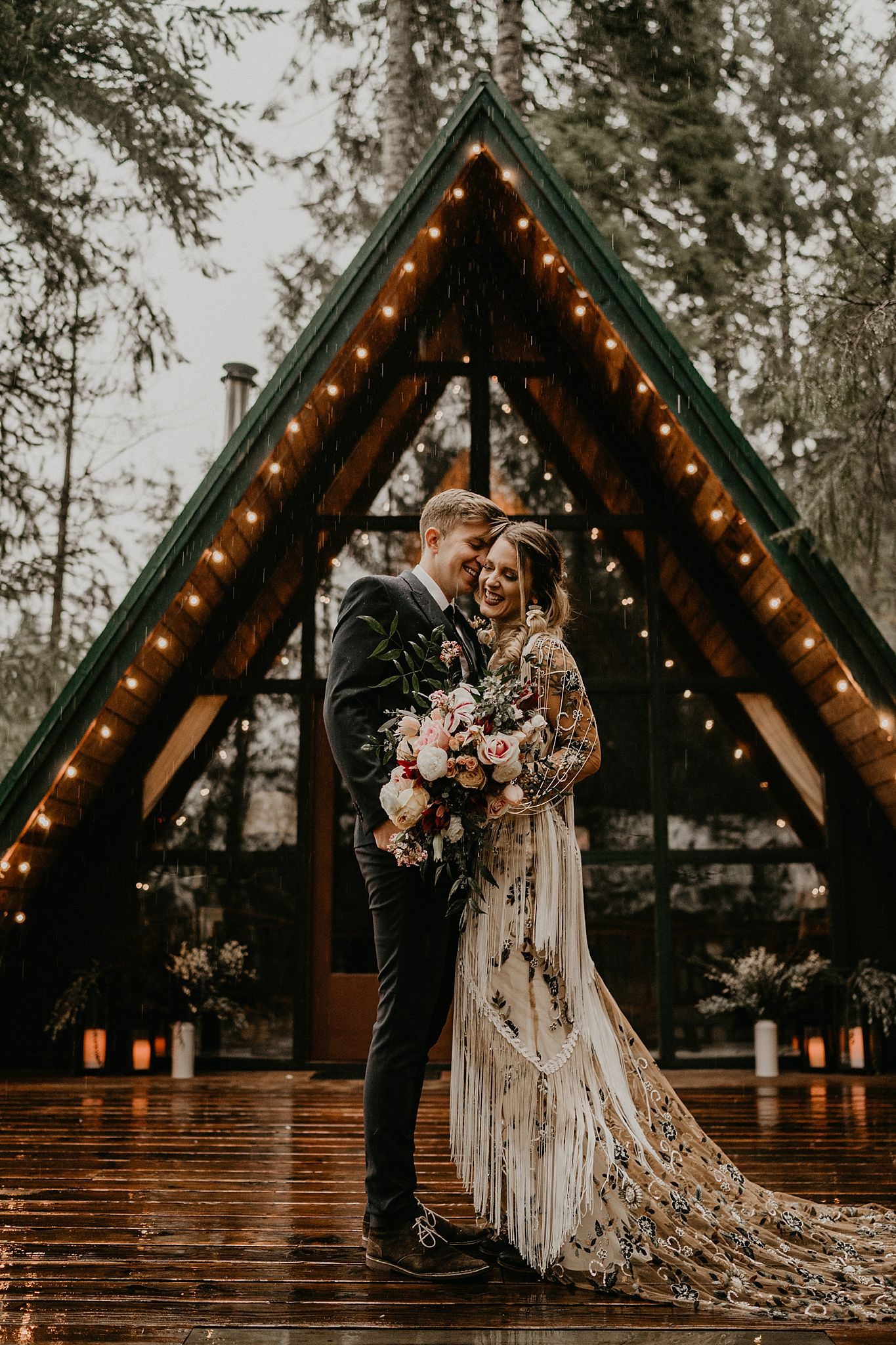 Bride and groom eloped in front of an A-Frame Cabin in the rain of pacific northwest