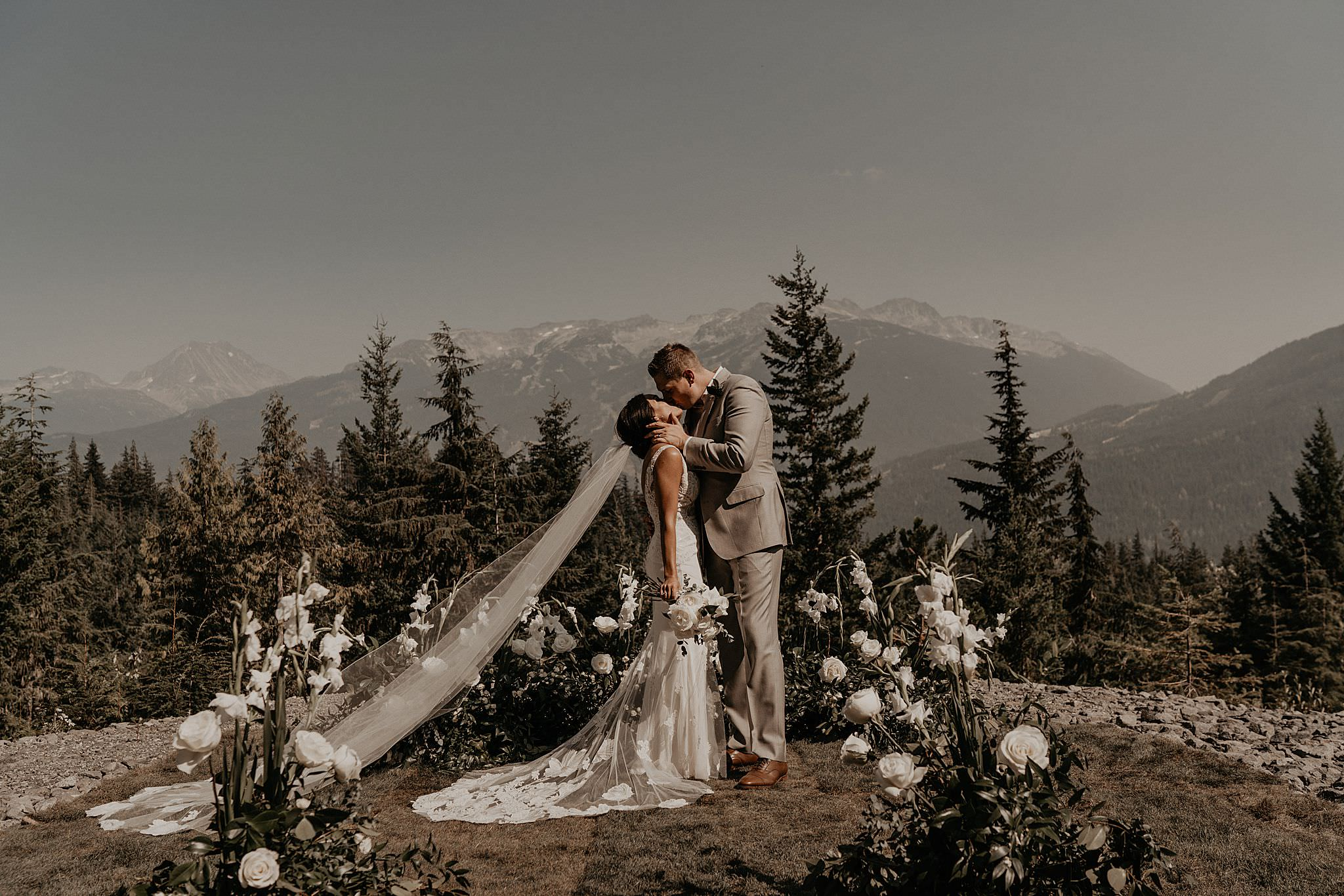 Epic first kiss captured by the best Whistler Helicopter Wedding Photographer