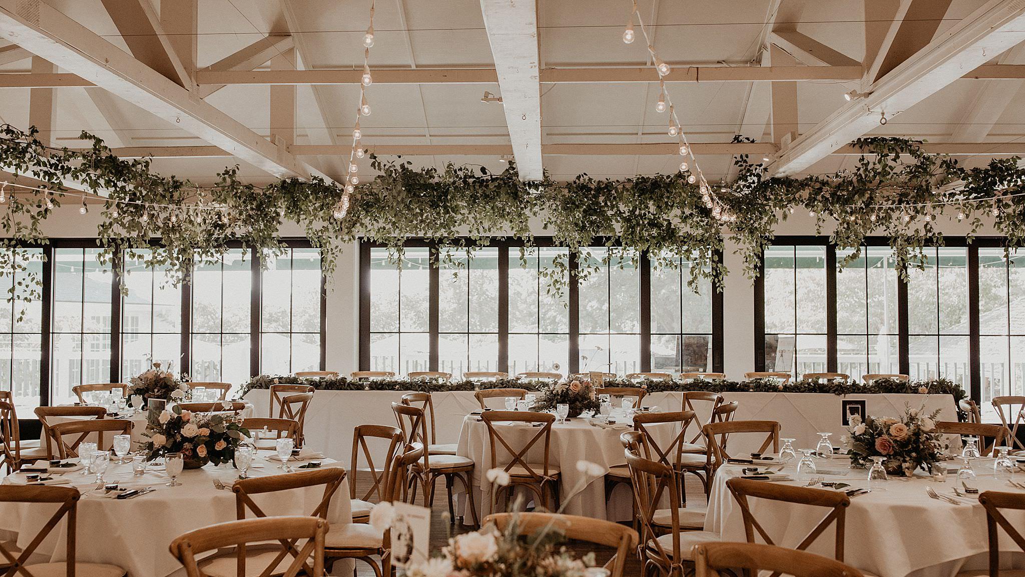 Beautiful greeneries and eucalyptus decoration wedding reception tables Roche Harbor wedding