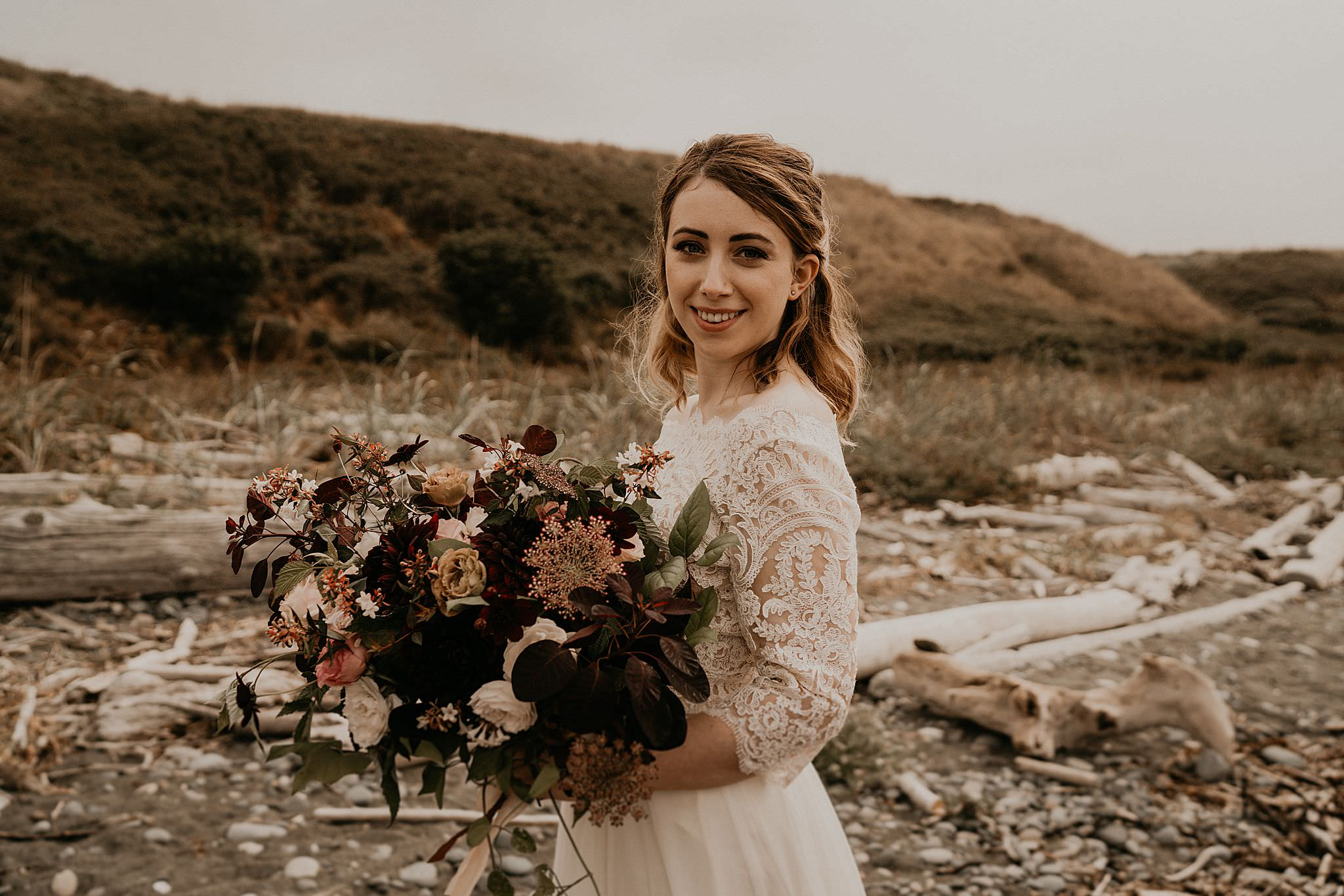 Bride and her beautiful bouquet on Whidbey Island at Ebey's landing