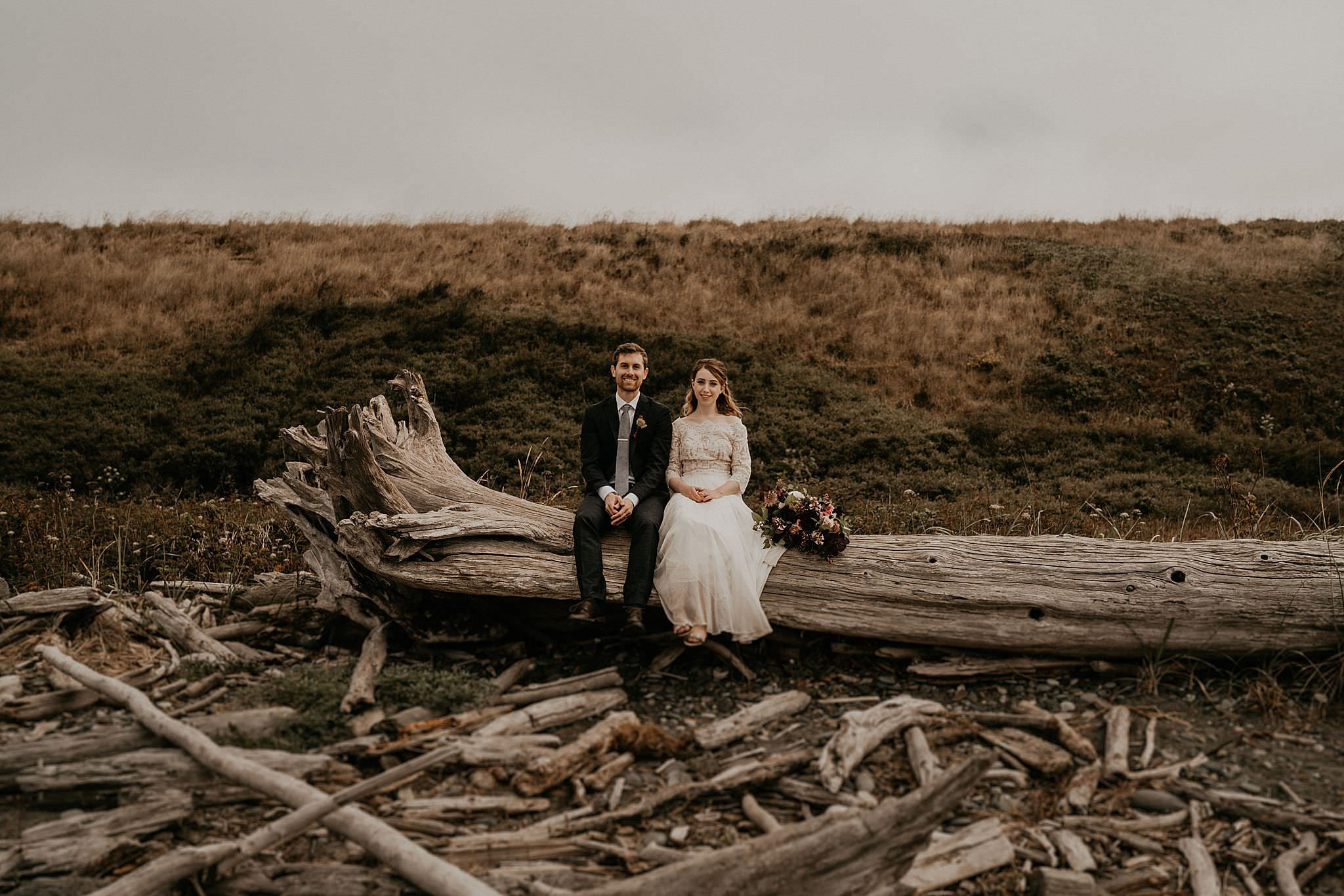 Newly weds celebrating their intimate elopement on Whidbey Island near deception pass
