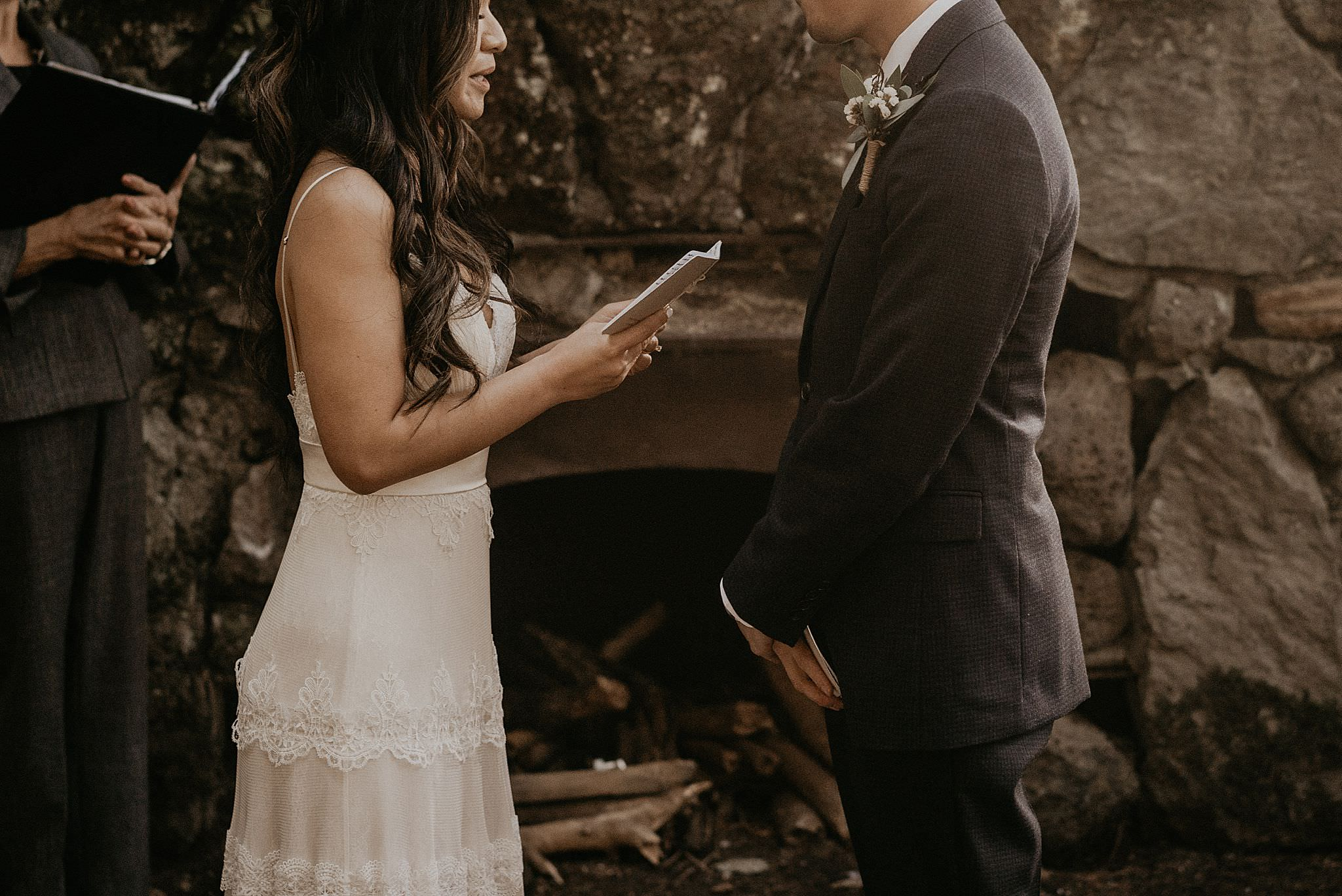 Bride reading her vows at the intimate wedding near columbia river gorge, skamania stone house
