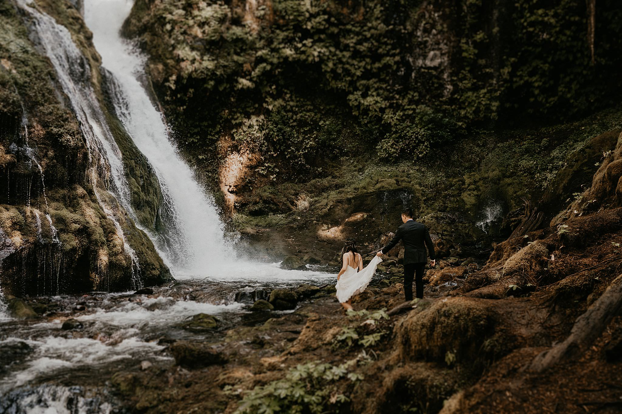 Couple explore Panther Creek Falls of Gifford Pinchot National Forest for their elopement