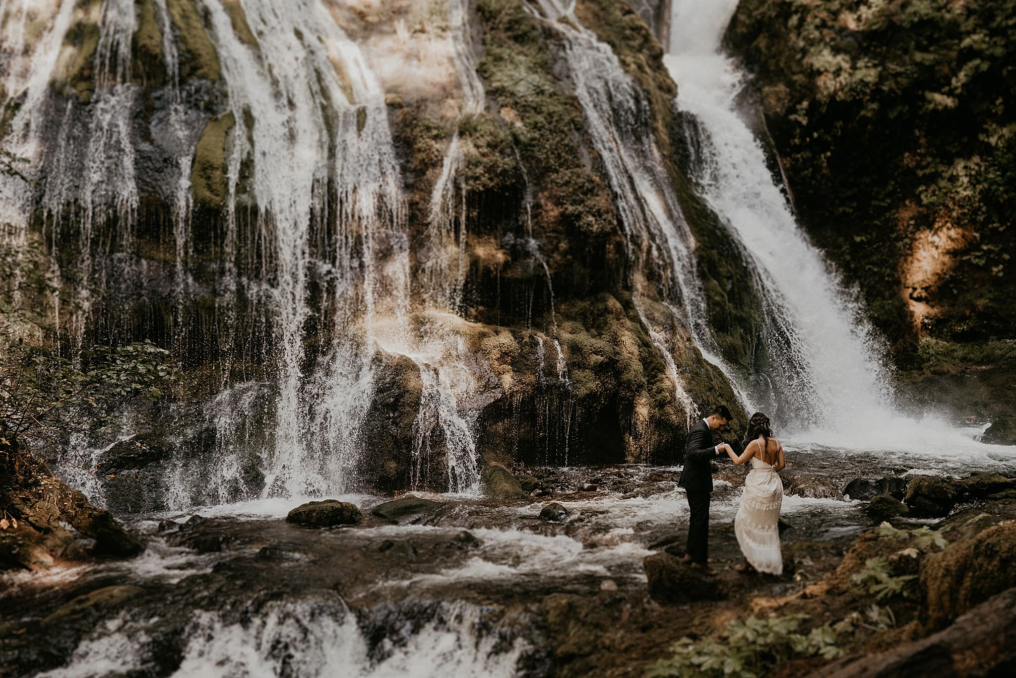 Beautiful bridal portraits at Panther Creek Falls for a forest elopement in Washington