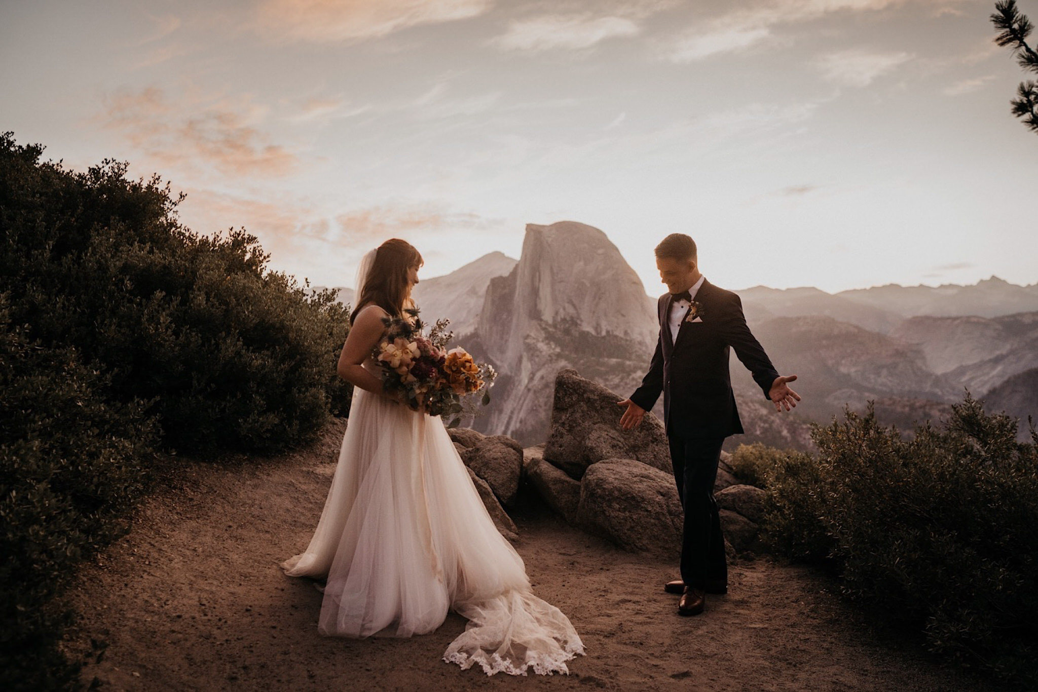 Yosemite elopement and wedding photographer with couple in glacier point