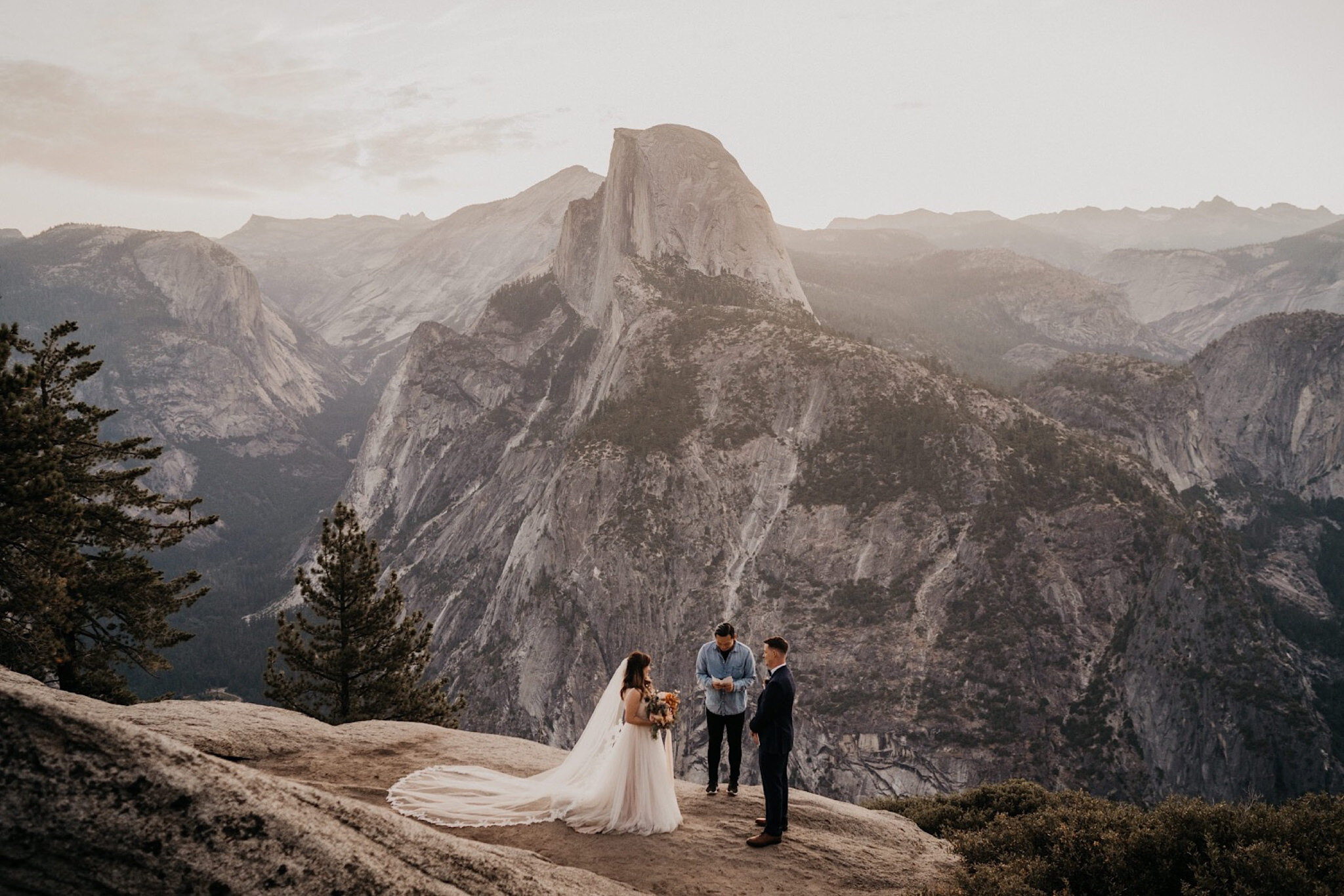 Bride and groom exchanged their vows in front of beautiful views of Half Dome in Yosemite National Park