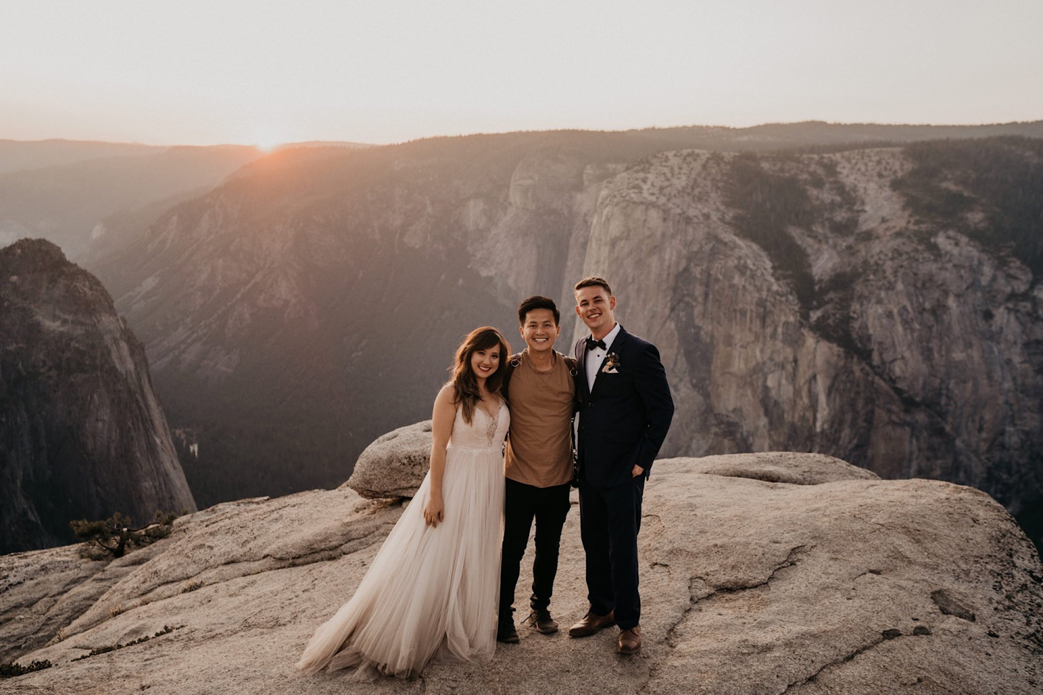 Henry Tieu Photography and bride and groom kissing him at Yosemite National Park during their wedding and elopement