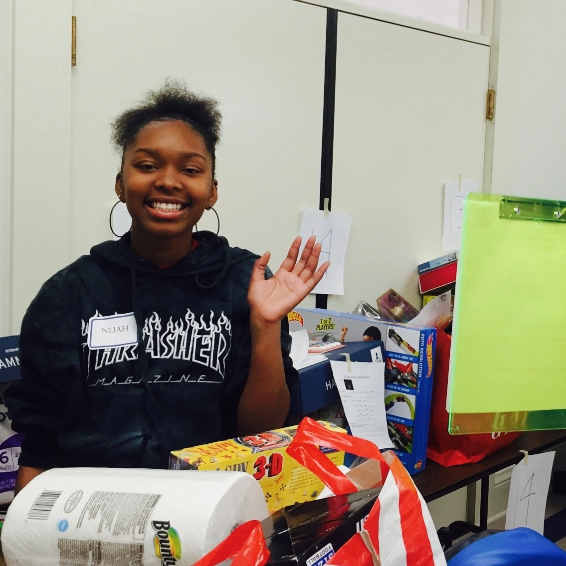 Nijah volunteering with Saint Vincent's Day Home to put together Christmas packages for families.