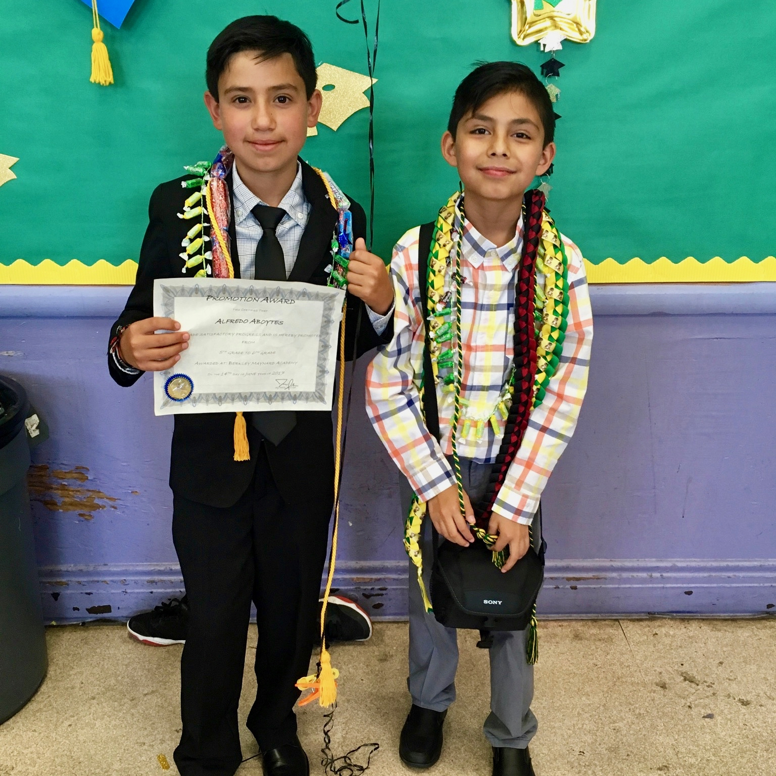 Alfredo (left) with his best friend Julian at their 5th grade graduation.