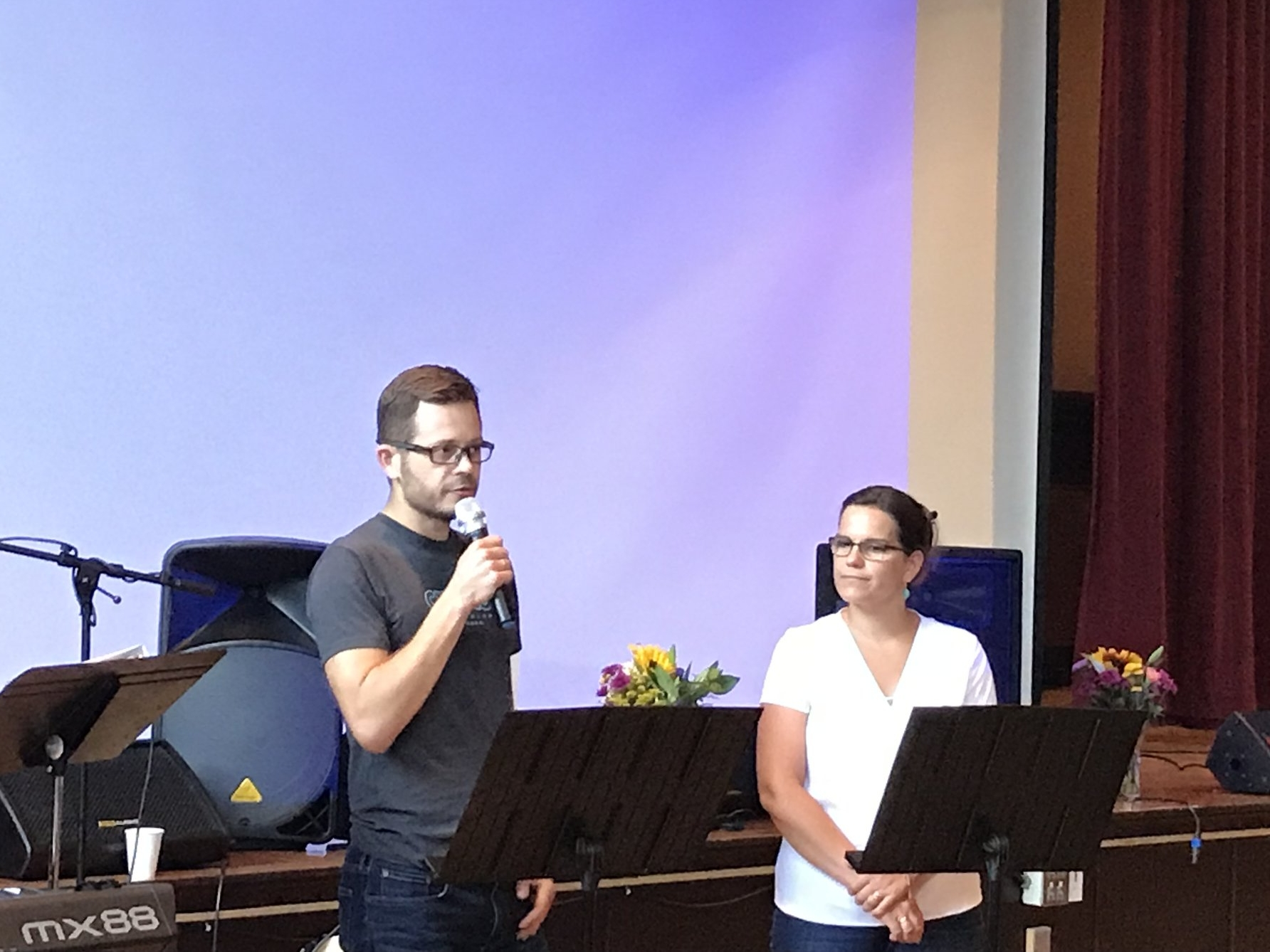 David and Jacqui preaching at transformation city church