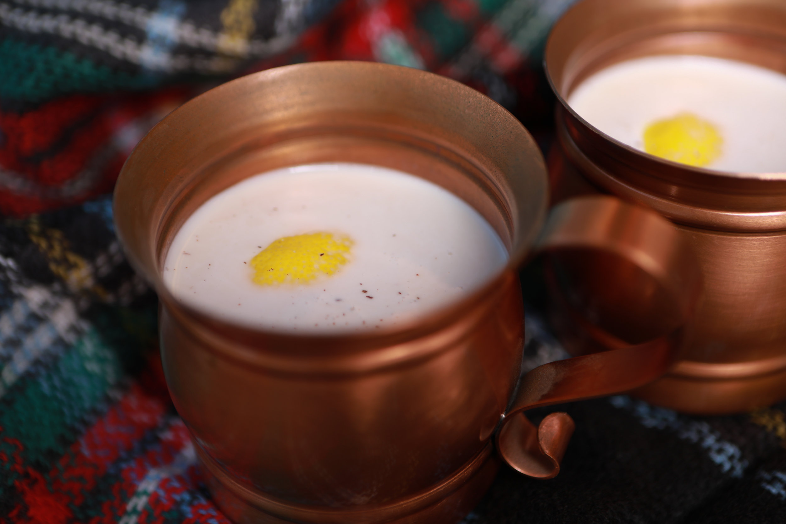 Ponche Crema - A traditional Venezuelan holiday recipe, we're bringing it stateside to prove that there are tastier alternatives to eggnog.Ingredients include two types of milk, eggs, lemon peel, vanilla, and aged rum.Also available as a non-alcoholic punch.