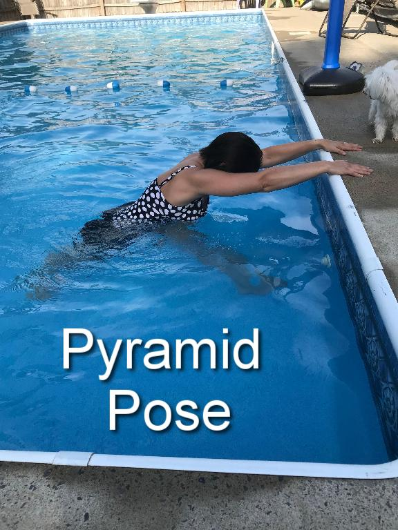 Step one leg back and hinge forward from the hips and place hands on the edge of the pool. Repeat on the other side.
