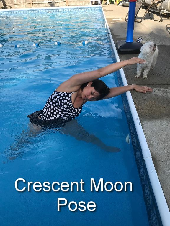 One foot is pointed toward the side of the pool while the other foot is perpendicular. Legs are wide apart, about 3-4 feet. The arm closest to the side of the pool will rest on the side while the other arm reaches straight up to the sky. Begin to lean toward the edge of the pool until your feel a gentle stretch. Hold. Repeat on other side.
