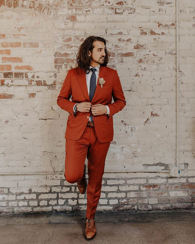 Congratulations to the newlyweds Mr. & Mrs. Deppe. It's been a pleasure working with Francisco on designing his dream suit for his wedding day. Don't be afraid to step outside the box and do something memorable. Pop some color and have fun. This is your big day.  Francisco is wearing a Peak Lapel Super 120s Burnt Orange Lightweight Suit paired with a Soft Grey Shirt and Robert Stanley Handmade Oxford Dress Shoes.  #RobertStanley #BurntOrange #Wedding #Groom #Bride