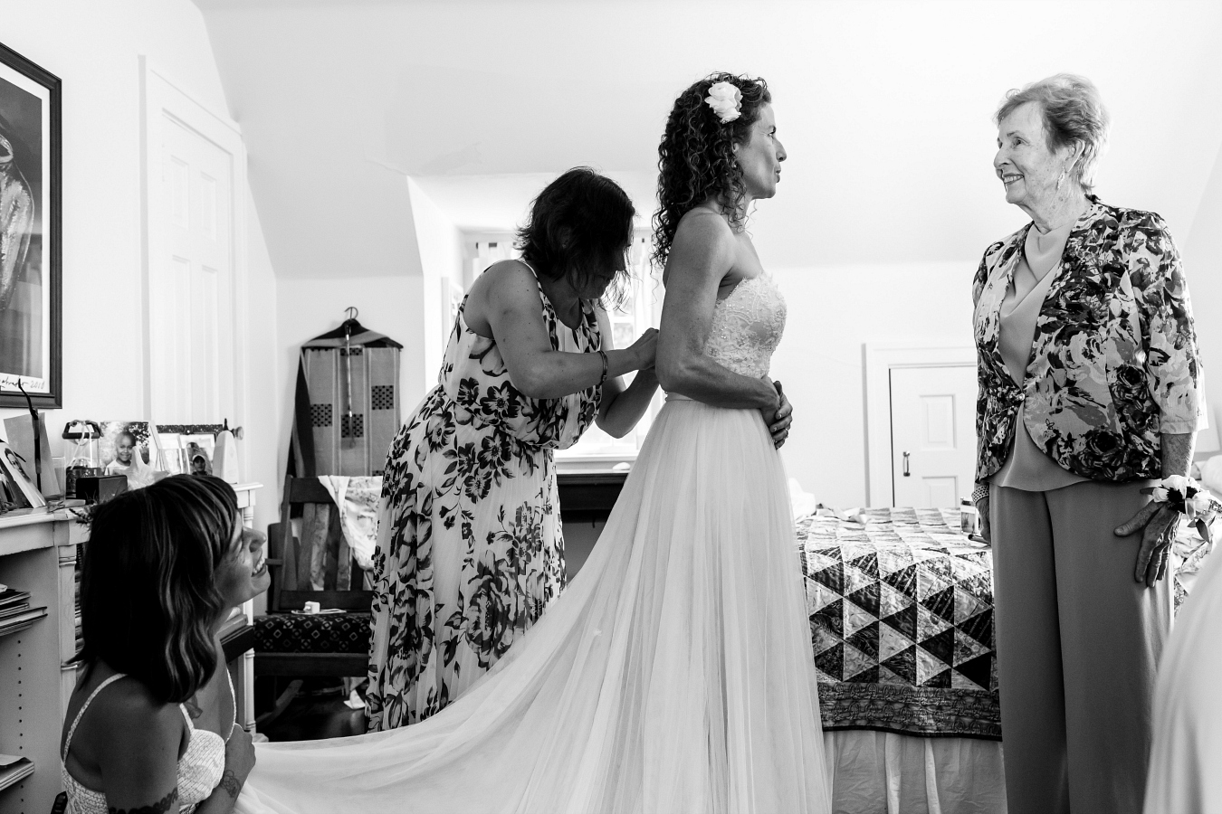 Bride Getting Dressed with Mother & Friends