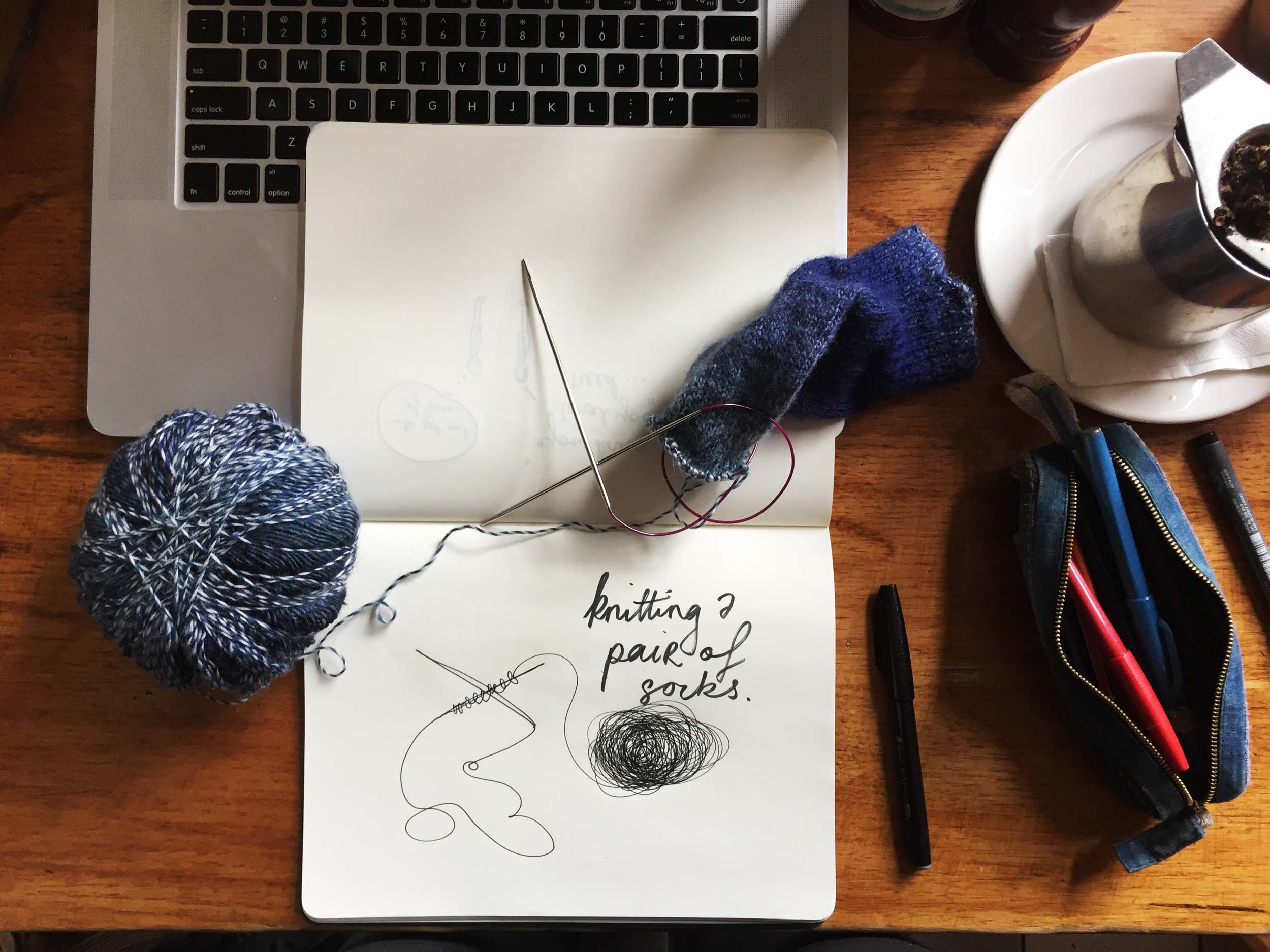 Knitting a pair of socks. Drawing Luke Hockley.