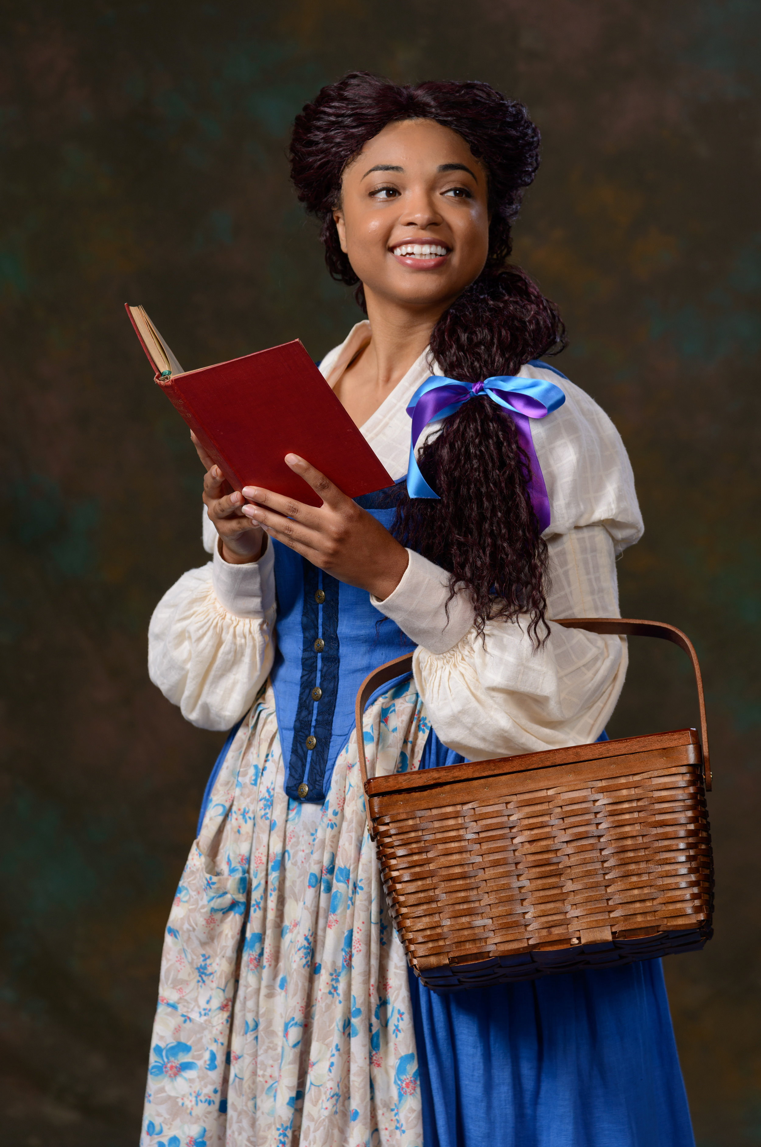 "Briana Brooks as Belle in ZACH Theatre's production of ""Disney's Beauty and the Beast."" Photo by Kirk Tuck."