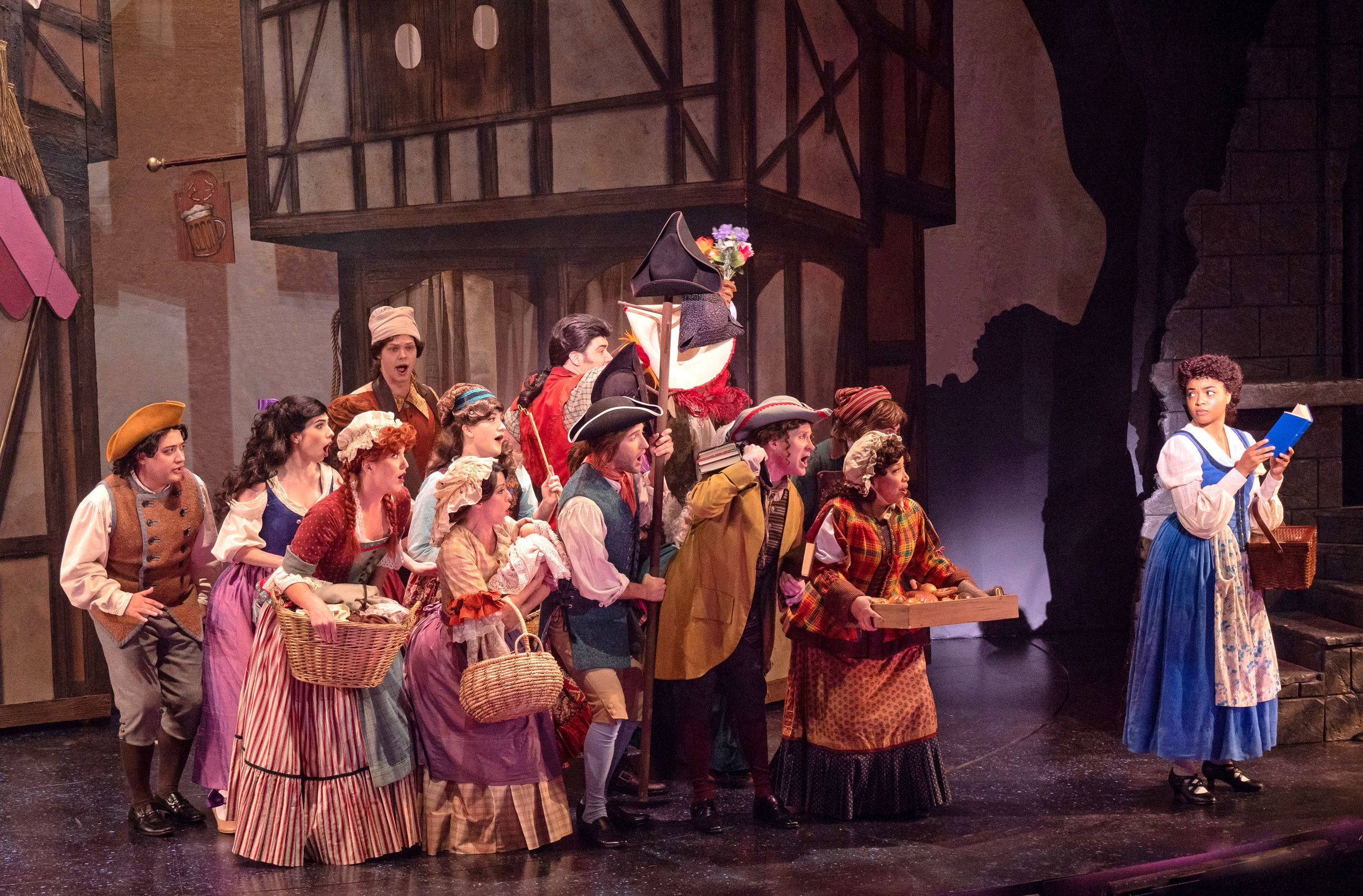 "Briana Brooks and cast members mid song in Disney's ""Beauty and the Beast."" Photo by Kirk Tuck"