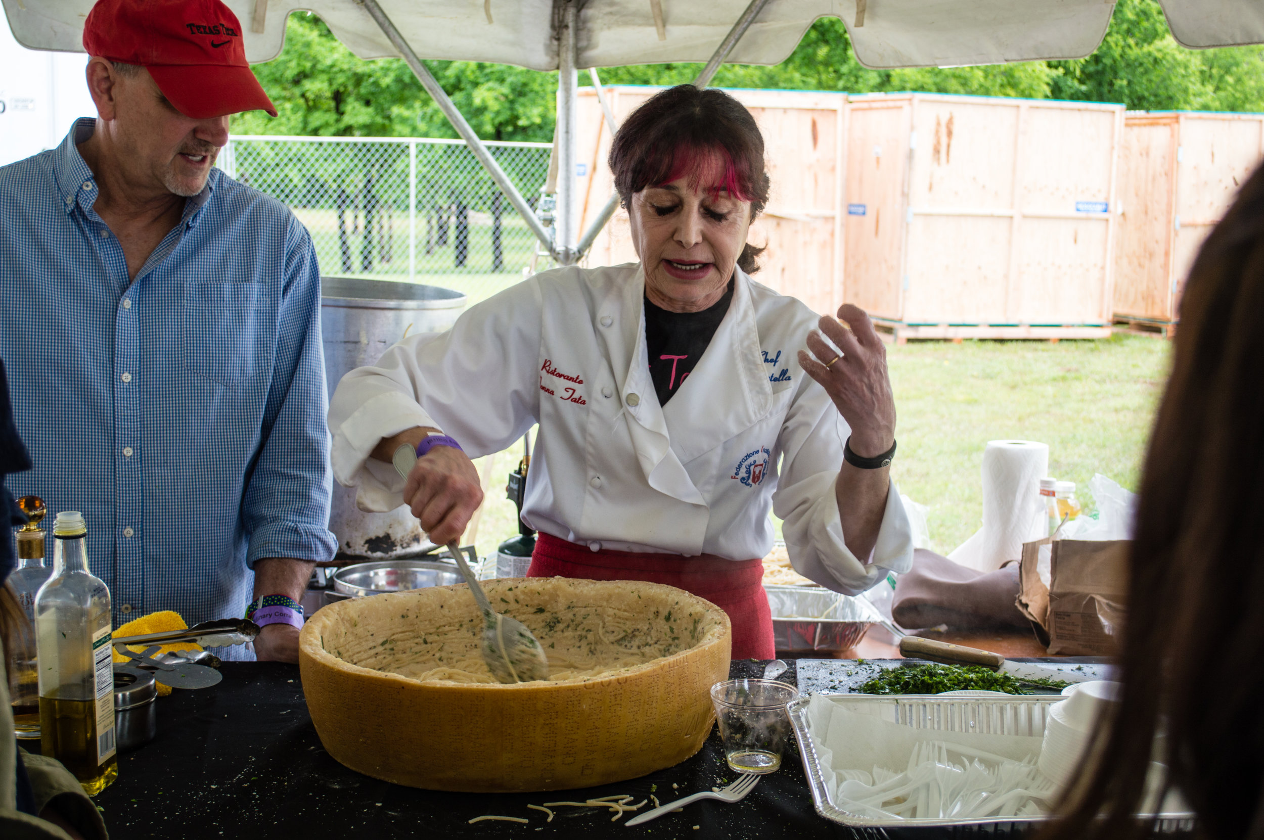 One of the talented chefs demonstrating her method of making pasta inside a wheel of cheese. Photo by Nick Bailey
