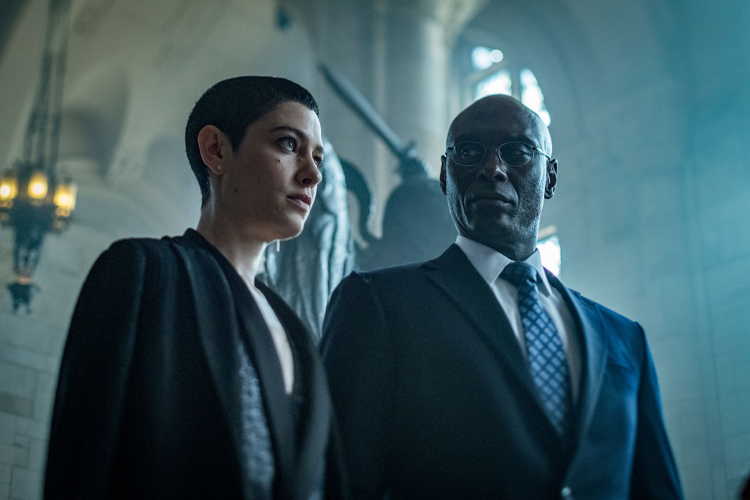 "Asia Kate Dillion as ""The Adjudicator"" and Lance Reddick as ""Charon"" in John Wick: Chapter 3 — Parabellum. Courtesy photos"