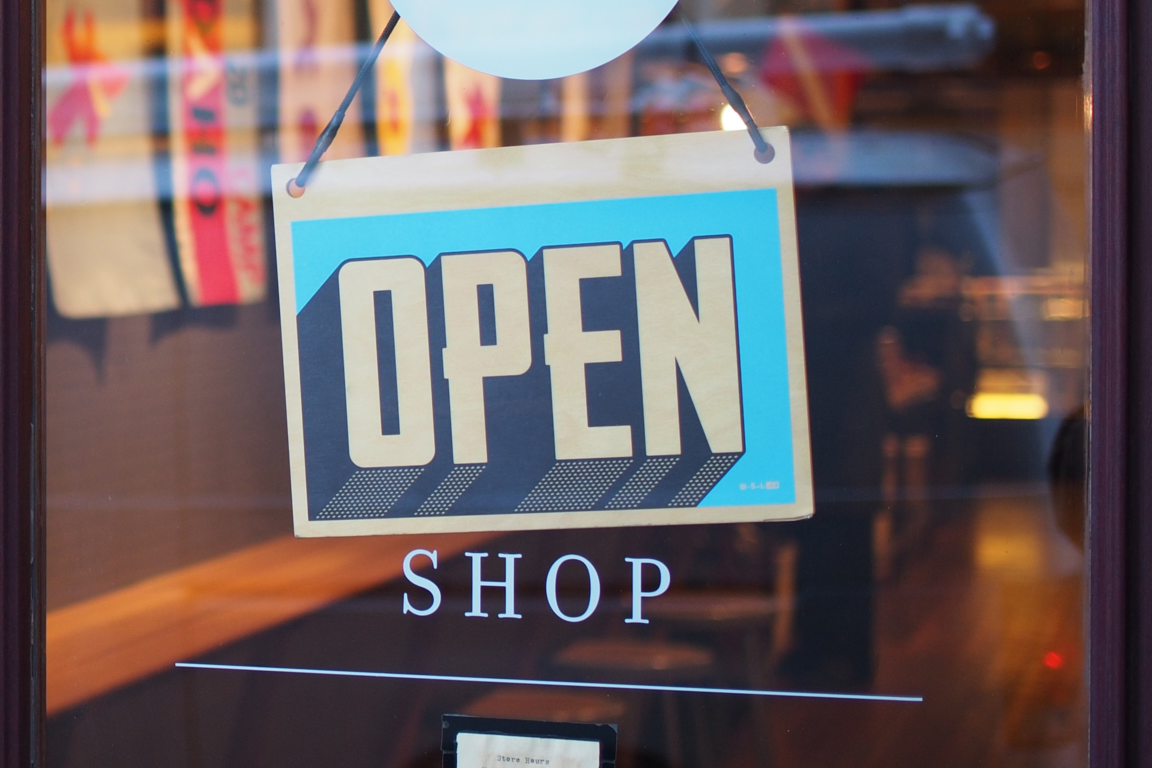 glass door with an open shop sign