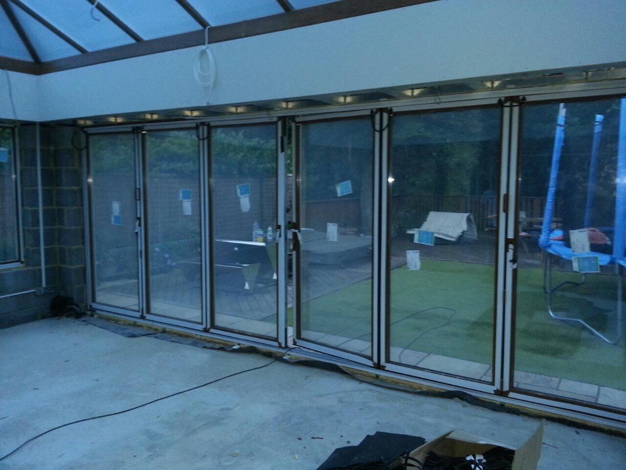 ELECTRIC GLASS FOLDING DOORS - ON.jpg